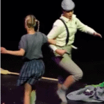 Picture of Gretel and Hansel dancing in the opera Hansel and Gretel